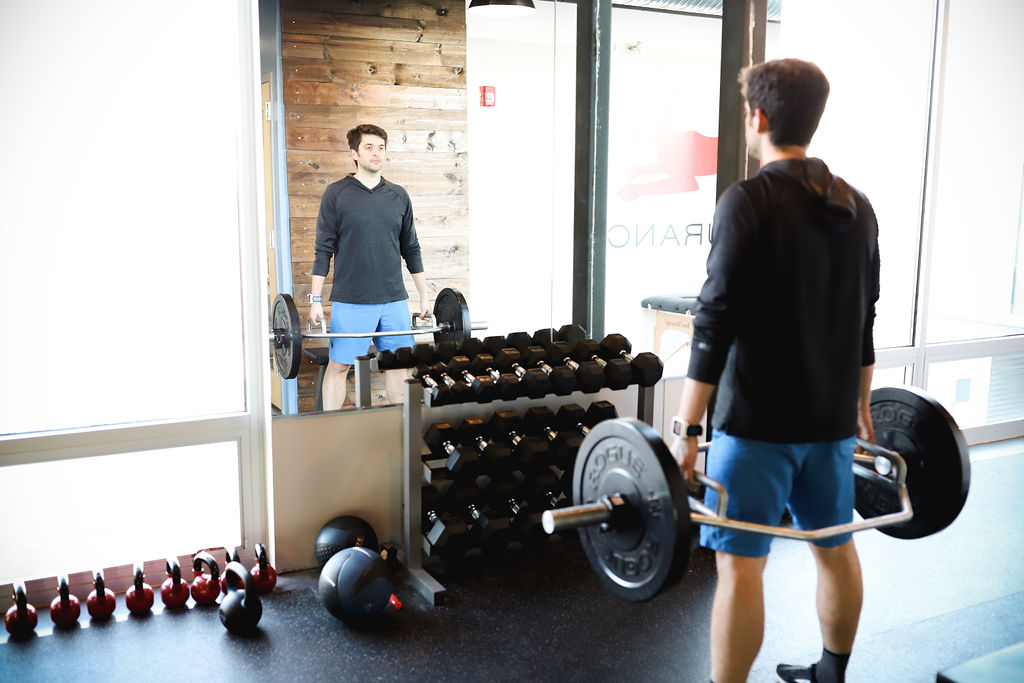 man deadlifting for strength training