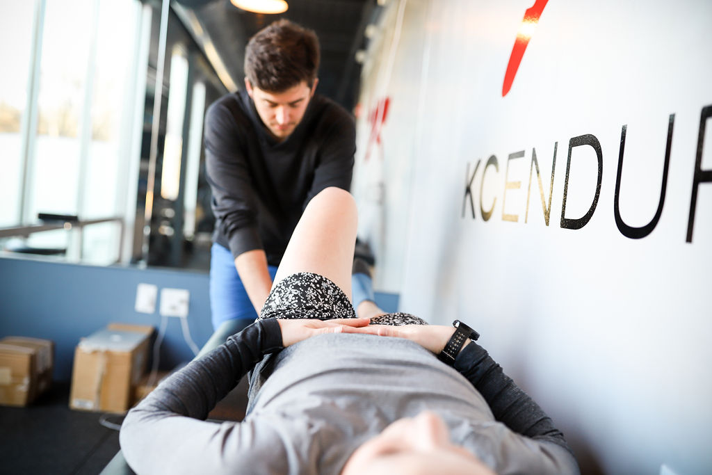woman on physical therapy table for assessment