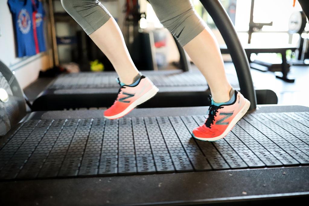 woman running on treadmill for running form analysis